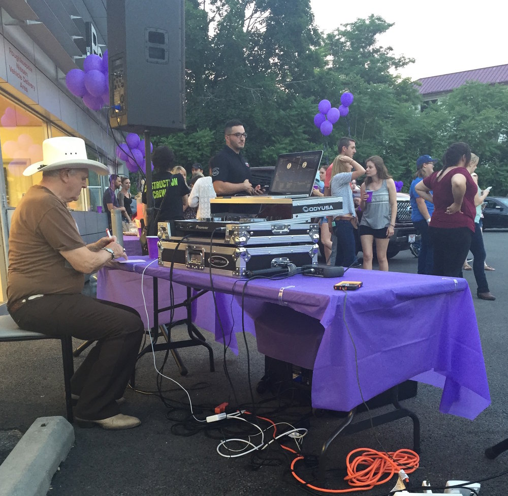 Getting the music ready for line dancing into the night! Photo Credit: Allie Bopp, A Little Beacon Blog