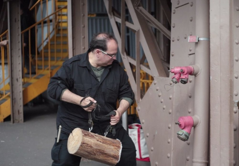 composer joseph bertolozzi at the eiffel tower with log. photo credit: Blue wings press, 2013