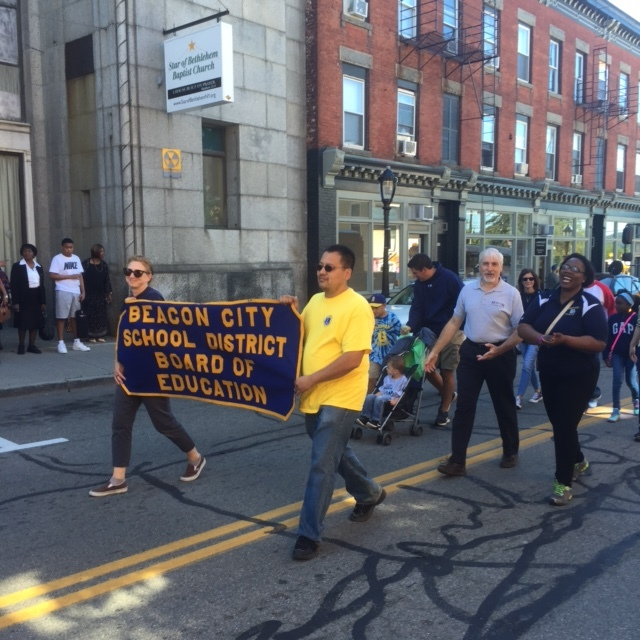 The Beacon City School District, with Meredith Heuer and Antony Tseng holding the banner, and Anthony White, William Zoph and Kenya Gadsen marching. Interim Superintendent Ann Marie Quartironi.