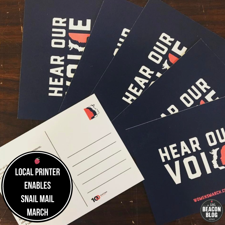 Grey Printing, based in Cold Spring, used the pre-designed postcard art provided by Women's March on Washington to print stacks of postcards for locals to order. Photo Credit: Grey Printing