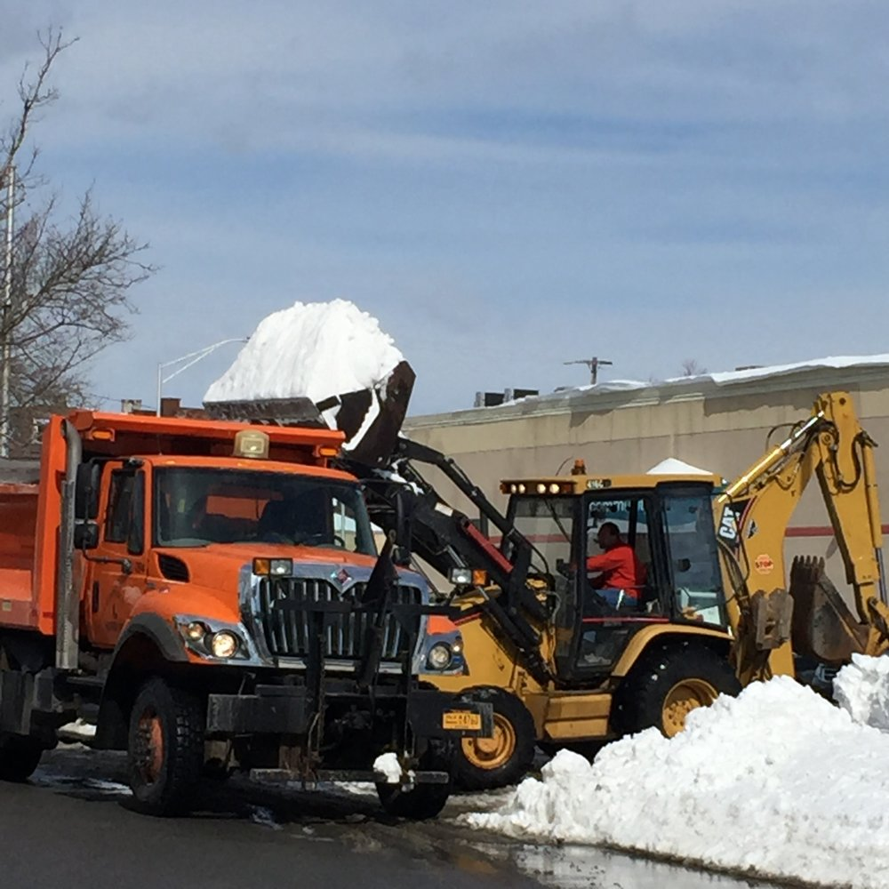 The public parking lot on Henry Street needs several trucks to cart away snow.