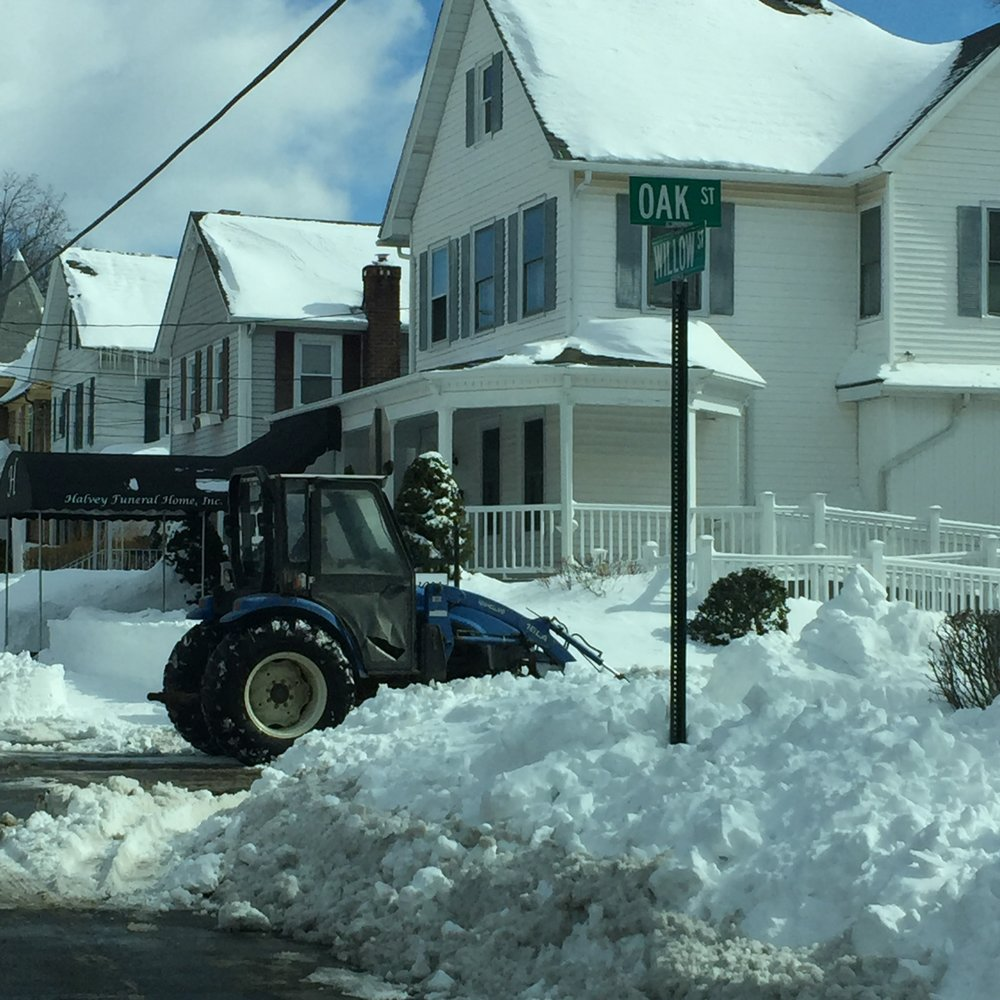 Harvey Funeral Home completely cleared their sidewalks and street parking with a bulldozer.