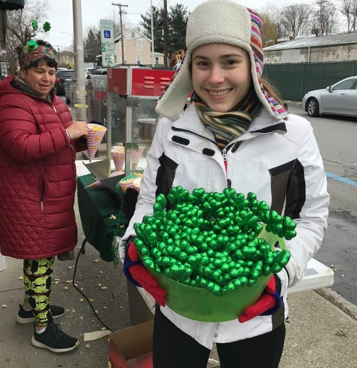 Madeleine Ouellette of King Family Chiropractic helps the Beacon Chamber of Commerce sell green headbands.  Photo Credit:  Beacon Chamber of Commerce  and Kate Rabe