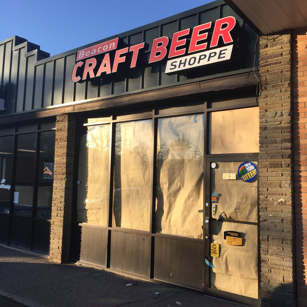Regulars of the check cashing store tried to go into the brown paper covered door while the Craft Beer Shoppe was transforming.