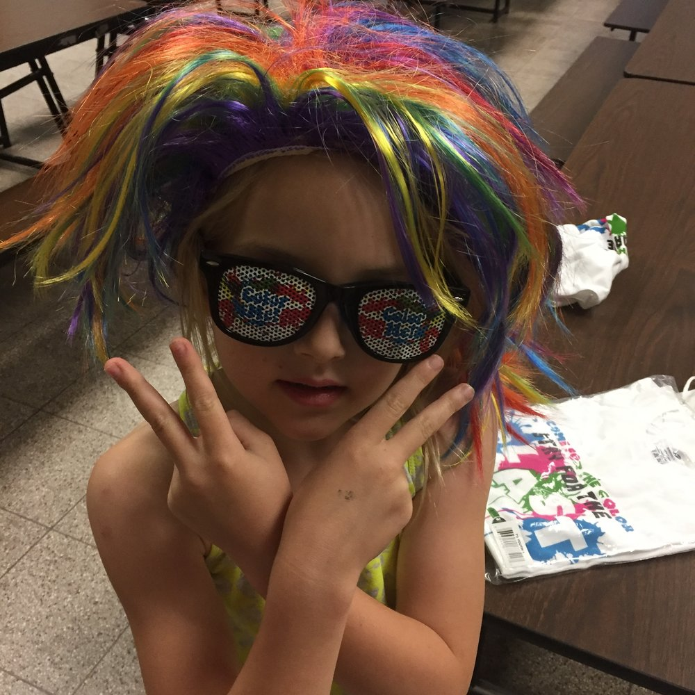 The wig and sunglasses might have come as prizes with our color registration bag.