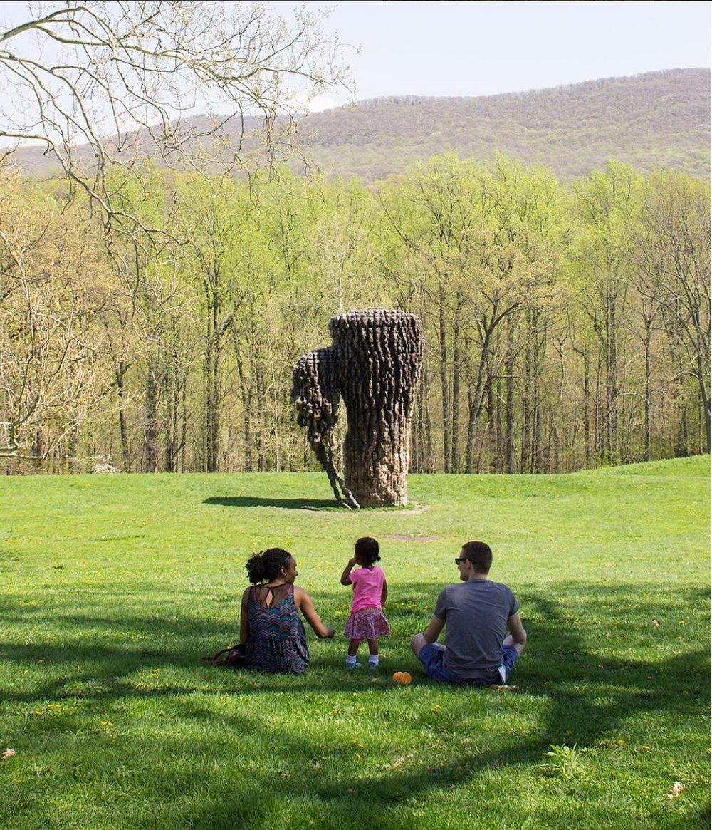 family looking at tree sculpture.jpg