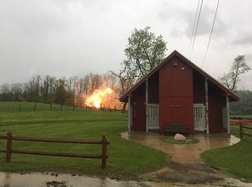 An electrical fire blazing on 9D, in front of Stony Kill Farm. This view is of their bathroom facing 9D. The fire was not in any of Stony Kill's buildings and all of their farm animals are OK.  Photo Credit:  Common Ground Farm