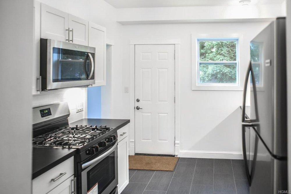 48 poplar street kitchen slate floor.jpeg