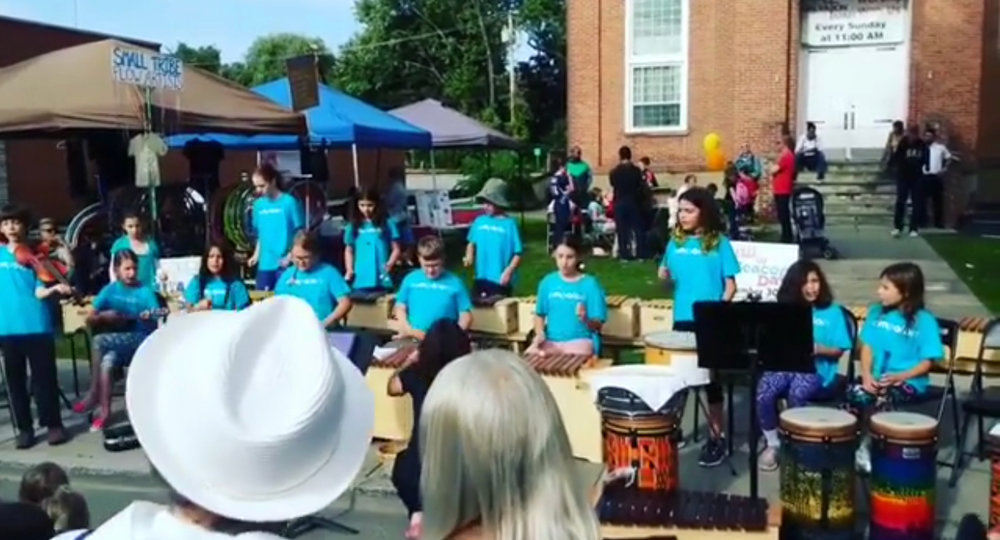 Kids from Compass Arts' Rompatom class playing music.   Photo Credit:    Screenshot from video from Angela Helland.