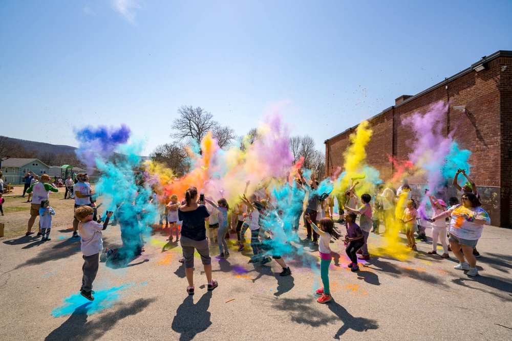 Celebration after the Color-A-Thon. Everyone is welcome to this community event and school fundraiser. Come! April 6, 2019. Photo Credit: Brian Doyle