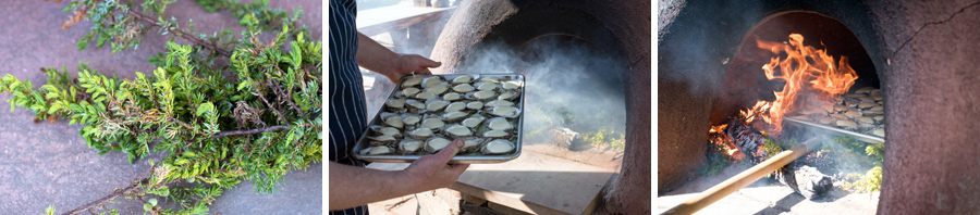 Smoking the oysters in the outdoor oven with juniper branches.