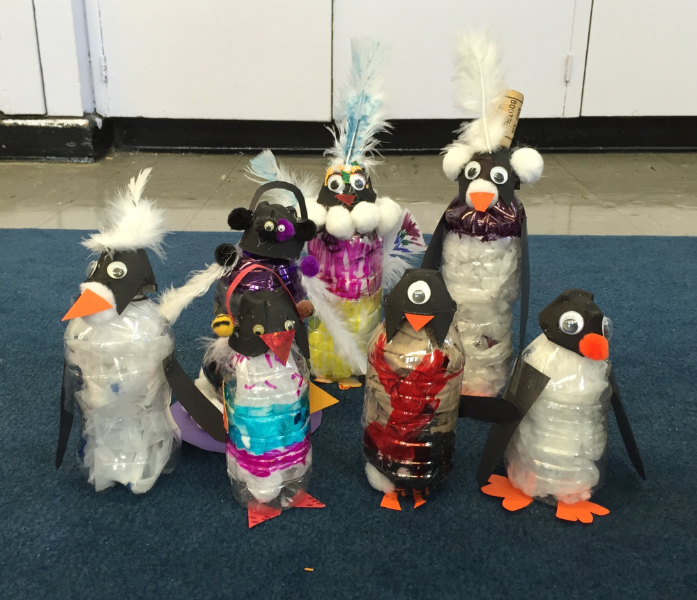 "Class 3 Results: Now that's a pack (?) of penguins!    First of all, it's hot. Like summer hot, and I'm wearing a sweater. AND my friend's cat is sick so I'm flying solo.   But now the kids hug me when I show up and scream in unison ""What are we making today??"" They claw at my bags to try and sneak a peak of the creature of the day.  I am blown away by the kids' creativity. I have my sample and they take it from there. Do you see those ear muffs? And the one-eyed armless small-footed creature?  Totally worth the sweat."