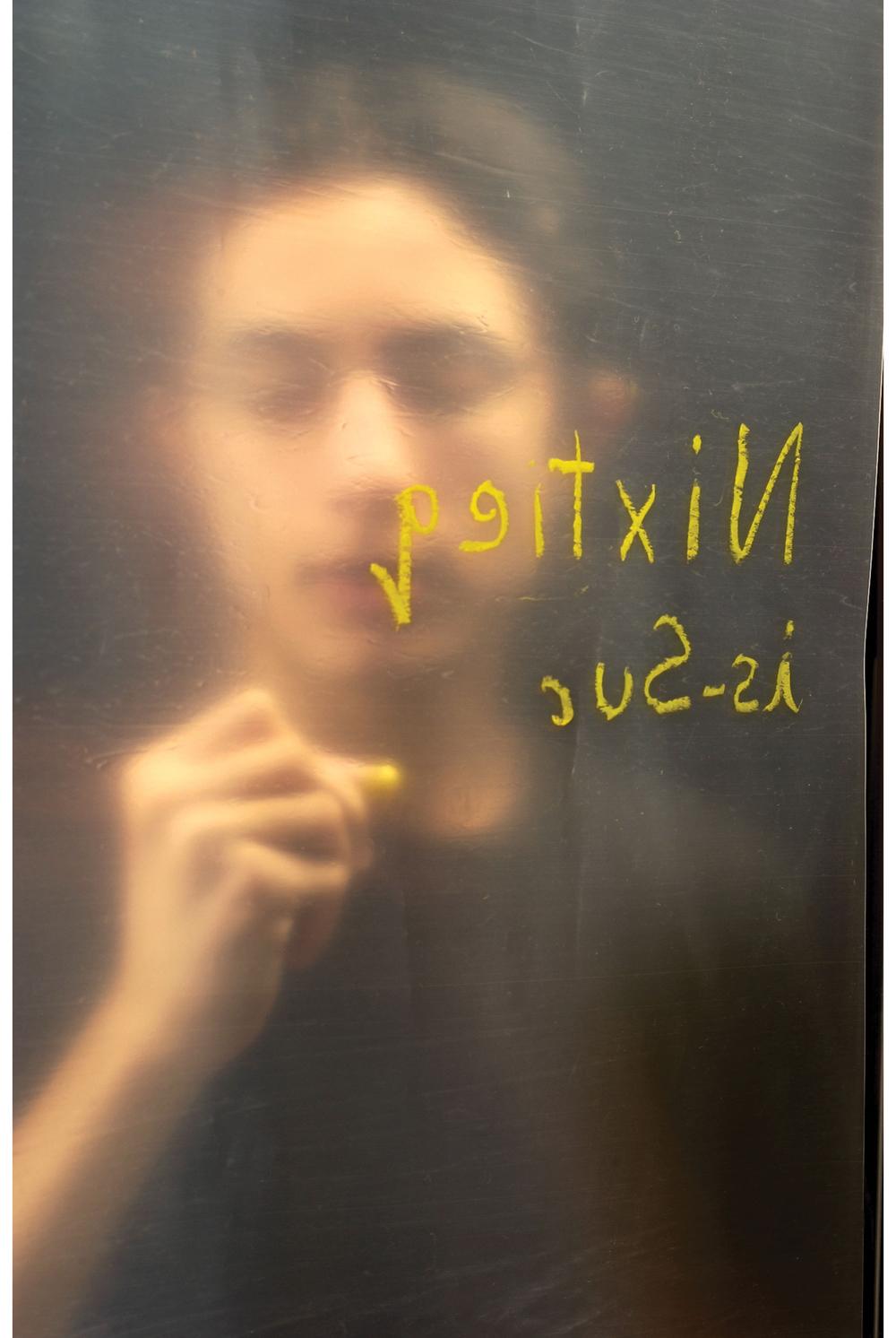 Nixtieq-Ivan-writing.jpg