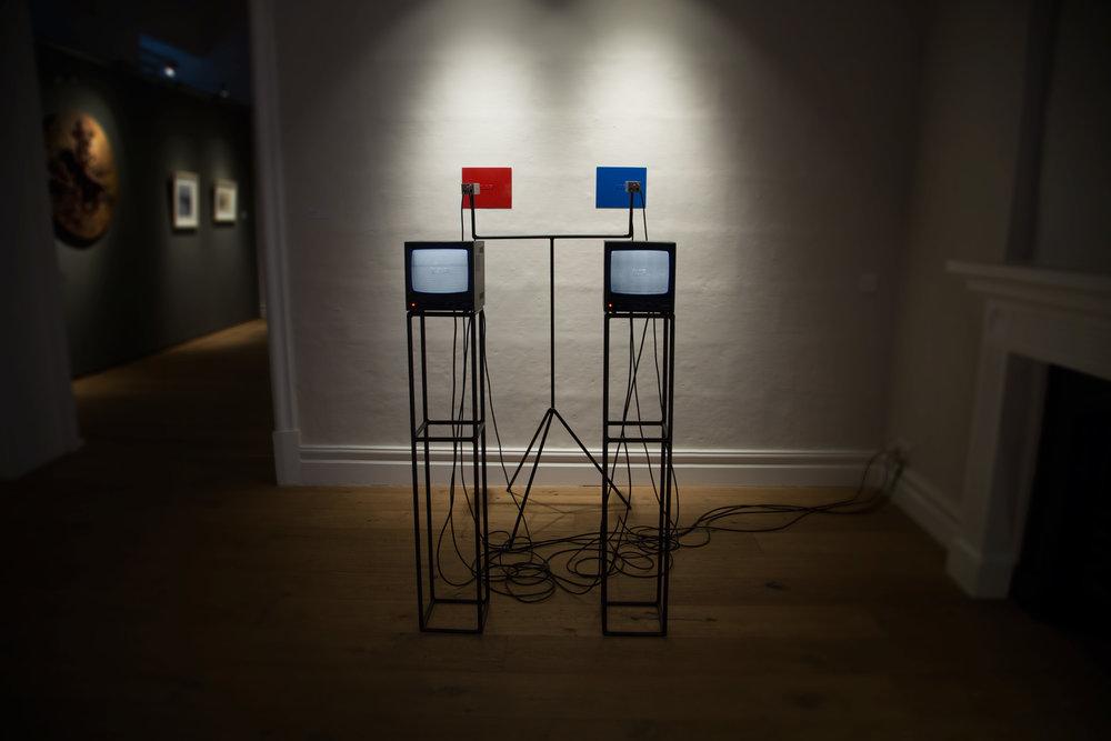 NAR-NIR (for AB),  text, plastic, paint, steel, CCTV cameras, CRT monitors , Human Matter exhibition, MSA galleries, Valletta, 2017