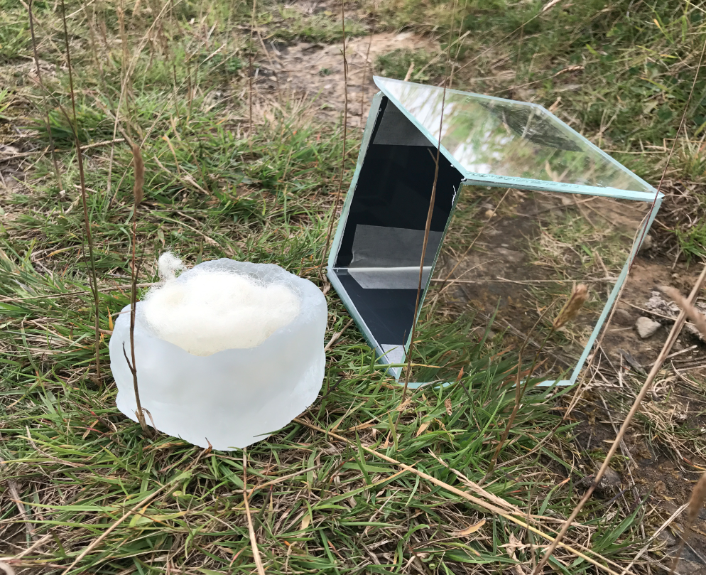 2017  4'' squared  glass with hand etched viewfinder (site specific installation Lybster, Scotland)     *each box contains a 3'' square glass basket containing found wool, when one looks through the viewfinder the glass is not visible, prompting the viewer to lift the box and investigate