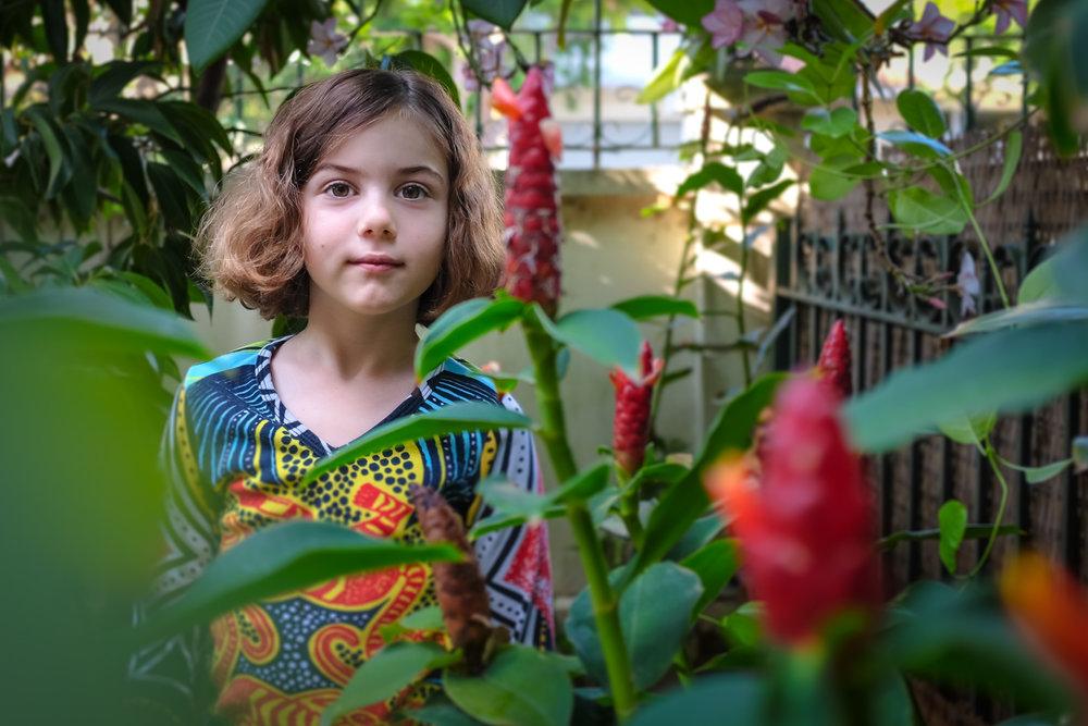 girl-colorful-portrait-in-bushes.jpg