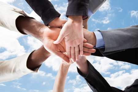 33439404_S_team_hands_work_together_staff_employees_sky.jpg