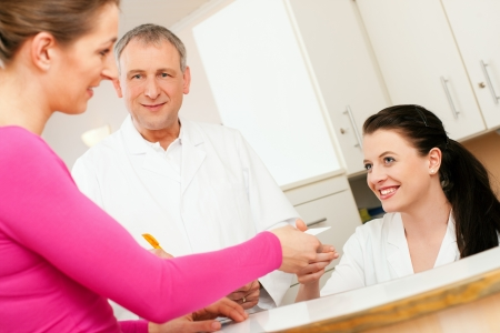 11911772_S_doctor_office_manager_patient_check_in_appointment_insurance_woman_man.jpg