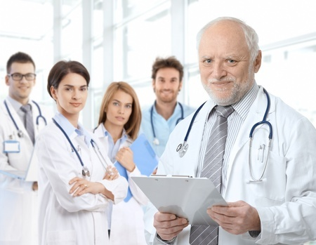 9654888_S_doctors_podiatrist_young_old_residents_stethoscope_white_coats_male_female.jpg