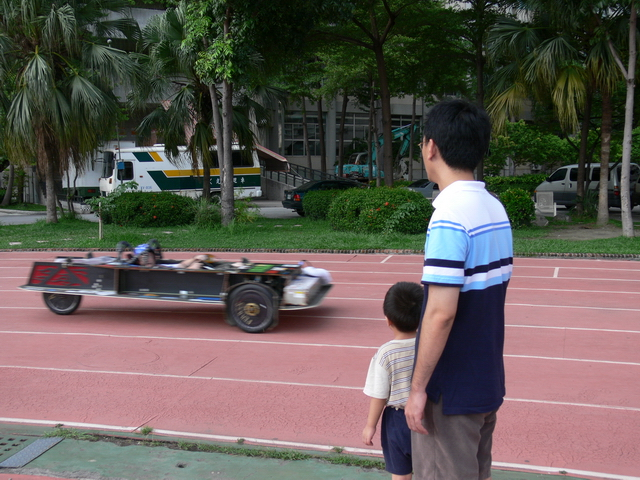 Jaques drives teh chassis around the track, as the first tests are conducted on the chassis to ensure that it arrived in working order. The car is a hit with the kids.