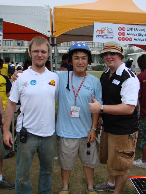 Sam and Pat grab a picture with Kei Nomura, one of the drivers for Ashiya University.
