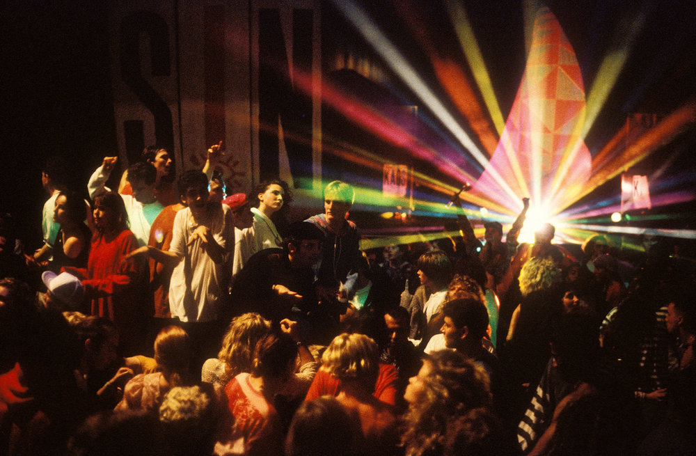 Ravers dancing to acid house at London's Astoria in 1988 (Photo: David Swindells)