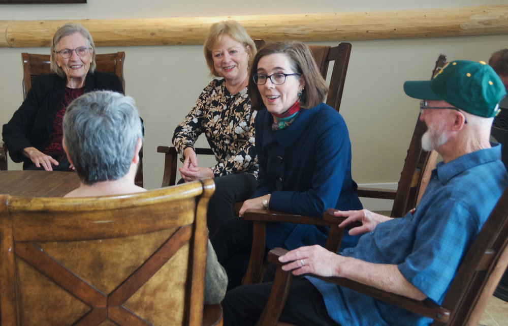 Governor Kate Brown gets to know some of our residents at IronHorse Lodge