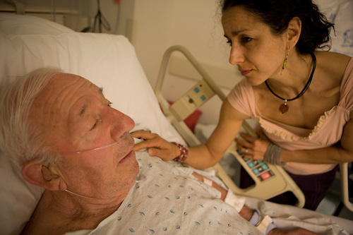 Julie Winokur keeps her father, Herb, company at St. Barnabas Medical Center in Livingston, N.J. Herb was admitted overnight due to his confusion from a recent fall.