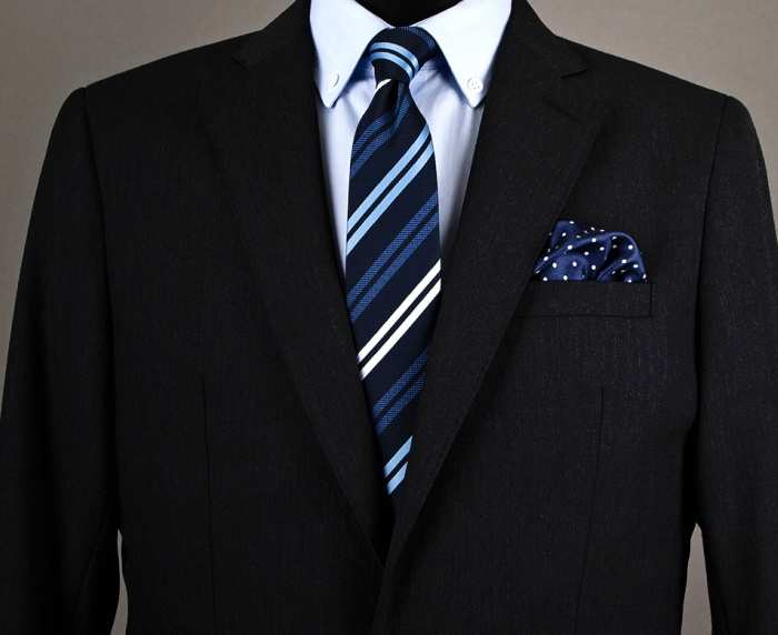 Note how the colors match of the pocket square match the tie, but not the pattern