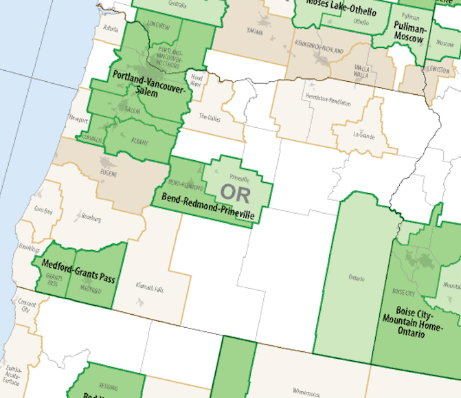 """Map 5. US Census Bureau Statistical Areas: dark green = a Metropolitan Statistical Area (MeSA) inside a Combined Statistical Area (CSA); dark brown = a MeSA outside a CSA; light green = a Micropolitan Statistical Area (MiSA) inside a CSA; light brown = a MiSA outside a CSA. The blank spaces on the map are """"not urban""""—that is, rural. Source: Wikipedia"""