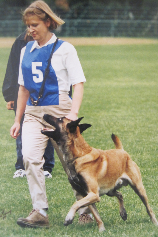 "With my ""heart dog"" Cory Ot Vitosha SchIII, IPO III. Here we are competing in Schutzhund nationals, 1999."