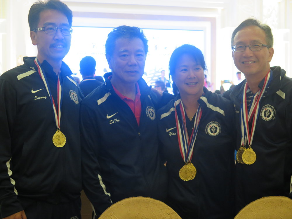 Posing with the Gold and her fellow, winning, teammates in China!