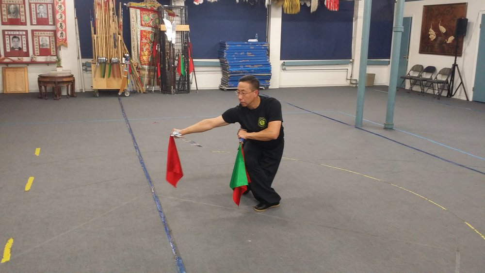 a diligent Paul Ho working his double broadswords form. Moy Fa Song Lung Dao.
