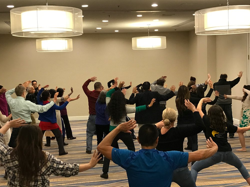 "Sifu Chin leads a very packed house in the Tai Chi Paradigm, ""Fan through the back"""