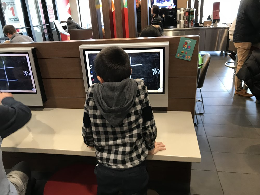This is not your grandmother's McDonald's! Touch screen entertainment and self check video kiosks! Very cool!