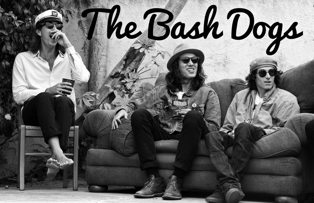 The Bash Dogs laughing on a couch