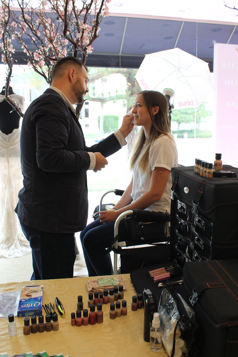 Robbie from R&R creating a soft bridal look on a beautiful Panache Bride.
