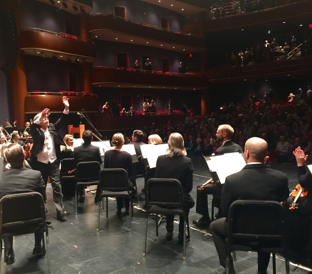 Maestro Grant Cooper responding to the standing ovation from the crowd on May 7, 2016 at the end of the performance.