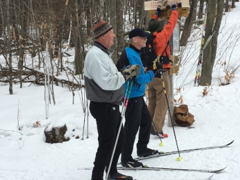 From the left is Johannes von Trapp, Charlie Yerrick and Sam von Trapp putting up the new trail sign.