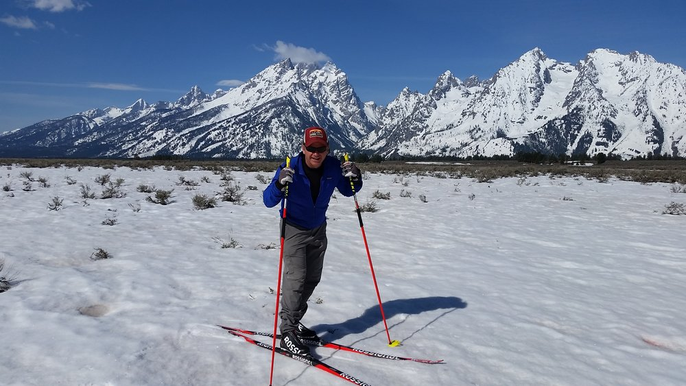 Scot McGee, ski pro posing in the sunshine under the Grand Tetons