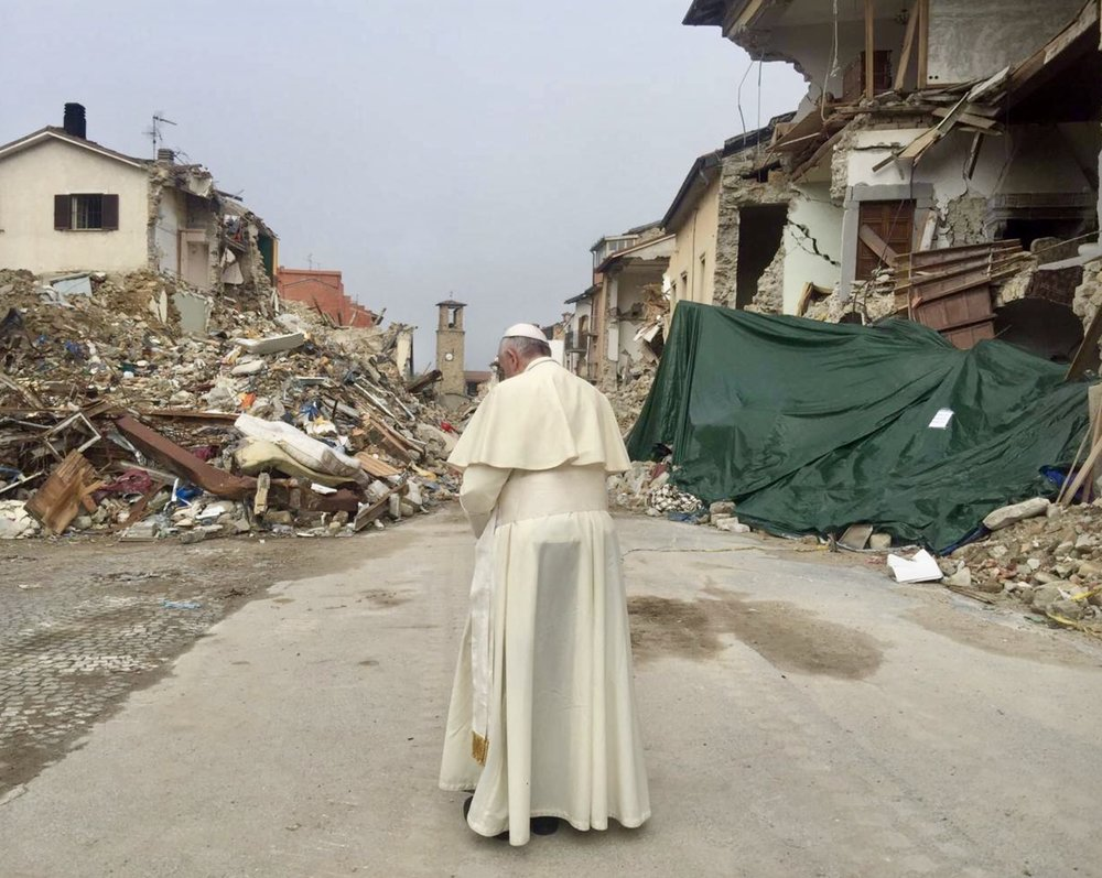 POPE FRANCIS VISITS AMATRICE TOWN, SITE OF ITALY EARTHQUAKE. (PHOTO CREDIT TIME MAGAZINE).