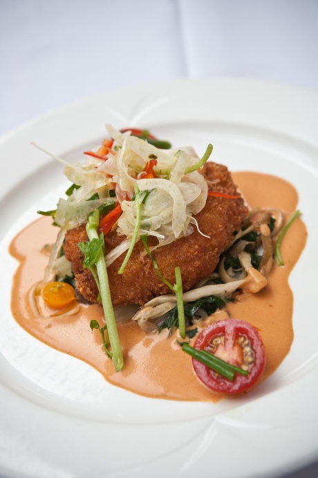 "2011's winning Maui Onion dish: Kekaha Shrimp & Lobster Cake with Swiss Chard, Hamakua Aliʻi Mushrooms & Lobster Uni Sauce by Chef Dave ""D.K."" Kodama in the Maui Onion Recipe Contest at the 22nd Annual Maui Onion Festival hosted by Whalers Village Fine Shops & Restaurants. Photo courtesy: Reflections Photography by Martin Wyand, Inc."