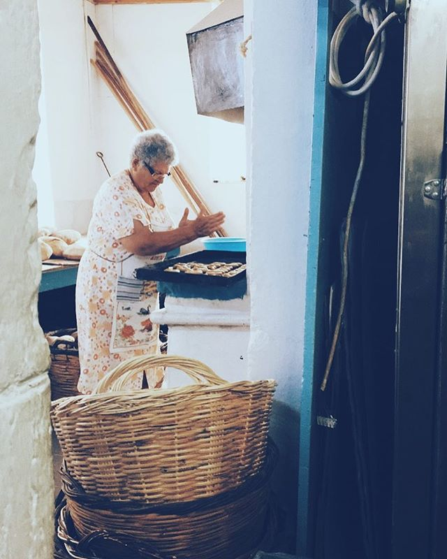 """Talk is the breath of life to a Greek!"" I said in observation of the bubbly old woman who was baking her own cookies in the cozy local #bakery of #Koroni, a #unescoworldheritage village in Southern Greece. Although Eleni, the priest's wife, claimed that her oven was broken and that she needed to borrow someone else's, the baker and I were convinced that she really came to socialize with all the customers buying their morning bread. She giggled and smiled, remarking on how wonderful it was to see the bakery filled with so many smiling young people. 🗣Have a special story about the person behind your delicious meal? Tag us at #HumanSeedsOfChange for a chance to be featured!"