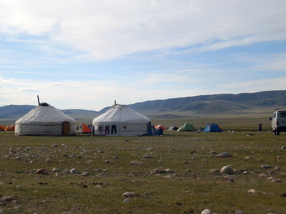 Setting up camp with yurts and tents