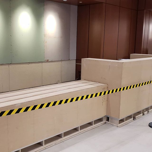 Setting the new security desk in the lobby.  #securitydesk #diewall #customcabinets