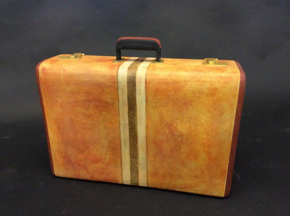 Suitcase, Head Over Heels