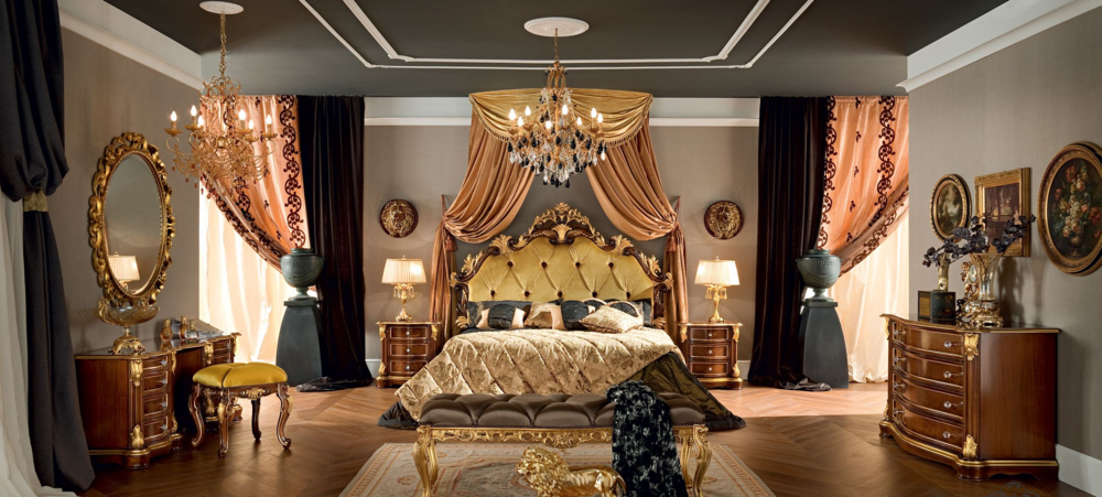 Double bed with upholstered and padded headboard. The four poster bed as well as the other furniture is realized with hardwood and the carved lines follow the Classic floral patterns. Each carve is covered by gold leaf applications and the pieces can be tailor made and accessorized in order to satisfy the most demanding request.