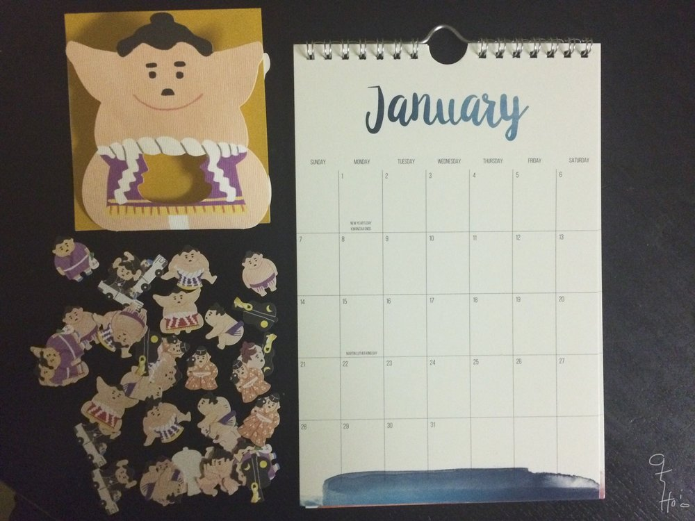 Turn mundane calendars into marvelous creations. I had fun with my sumo stickers.