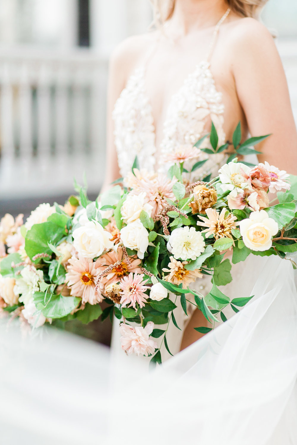 Splurge on The bouquet - It's in every photo. Real flowers may cost more but they smell amazing. There's also nothing like them!