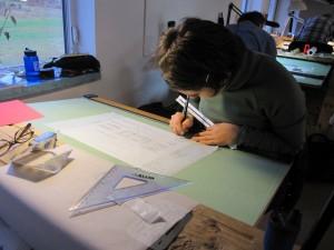 Lina drafting a tiny house